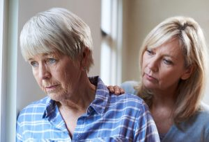 Younger woman looking caring and concerned for older woman who looks depressed, Rutland Health Network