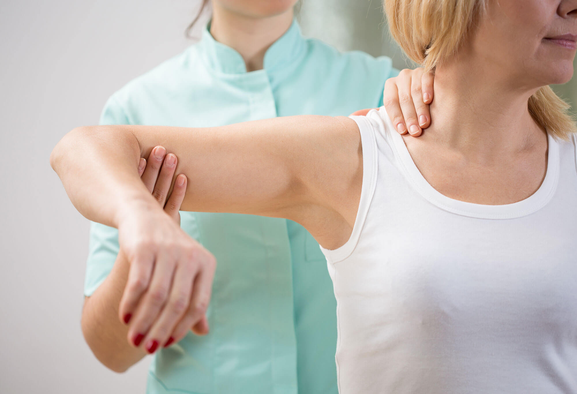 Physiotherapist testing muscle and bones in a young woman, Rutland Health Network